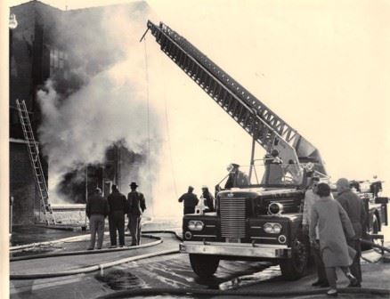 Old Photo of Fire Department Fighting Building Fire