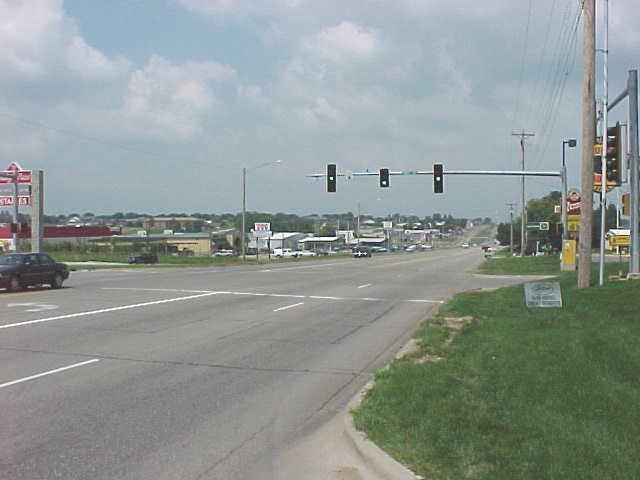 A four way intersection with a stop light.